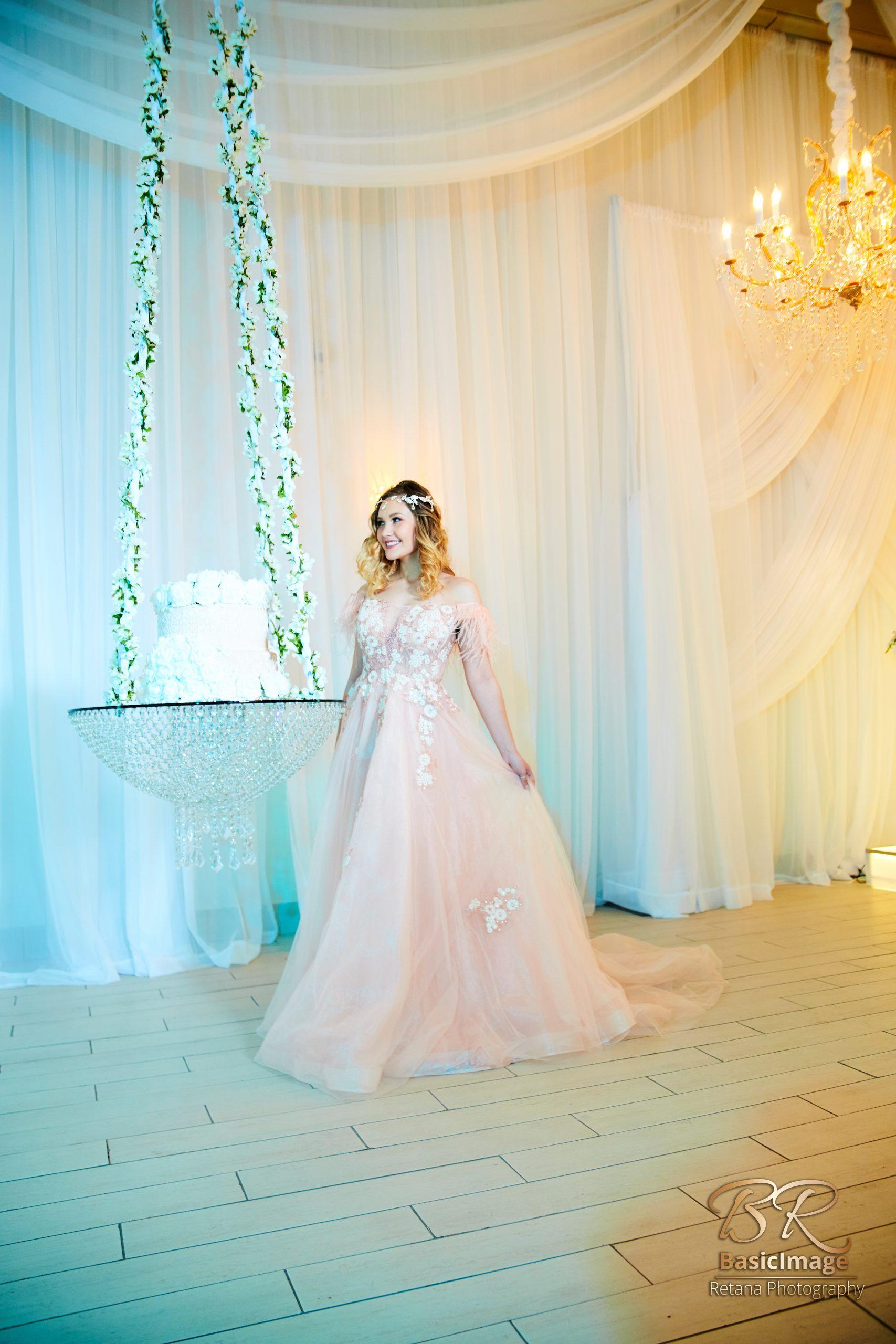 LeVenue front ballroom model pose near cake swing