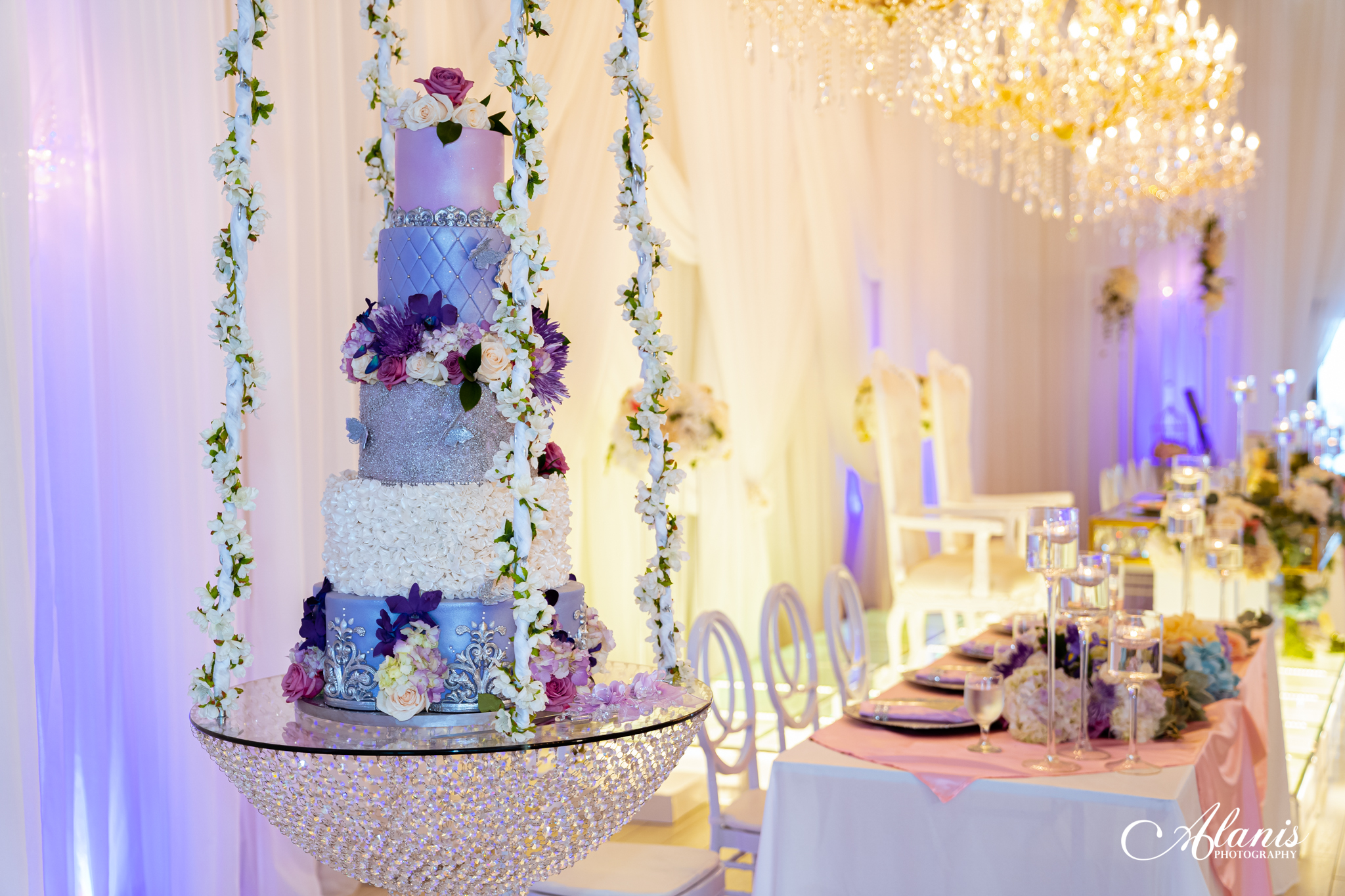 LeVenue close up of cake swing and front ballroom tables