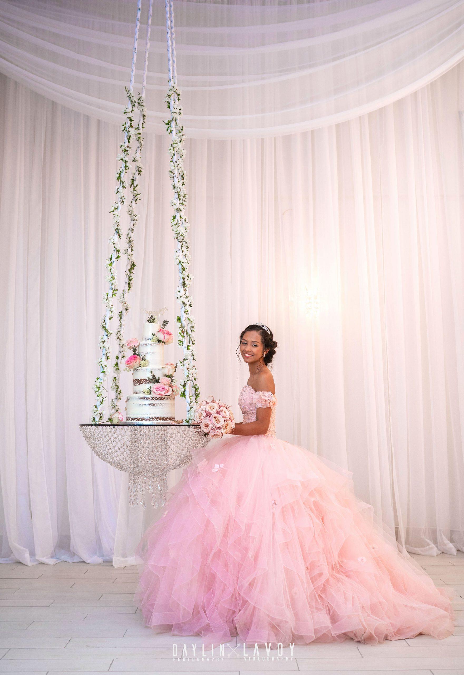 LeVenue Quinceañera cake swing and model